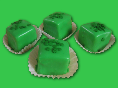 Petit Fours with green icing and green sprinkles
